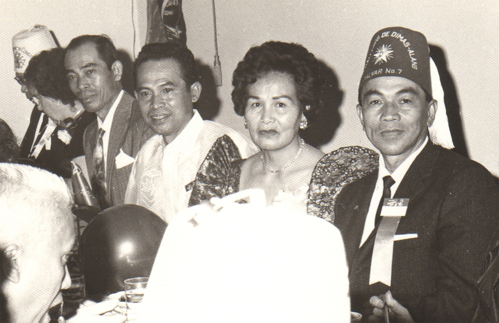 At a Caballeros de Dimas-Alang ceremonial dinner in San Jose, California, late 1940s. (l-r) Esteban Catolico, Mariano Catolico wearing a Barong Tagalog, Mary Cabebe in her terno, and Danny Cabebe (Source: Ragsac family collection).