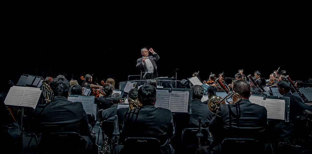 "Robert ""Bob"" Shroder conducts the Filipino American Symphony Orchestra (FASO), the only Filipino symphony orchestra outside of the  Philippines. (Photo by Ricky Gavino)"
