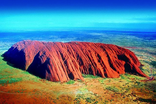 From the air Uluru reveals many of its peaks, ridges, valleys and ravines. This is not layered rock; it's one massive monolithic rock that has been weathered and eroded for hundreds of thousands of years. Nine-tenths of Uluru lies underground.