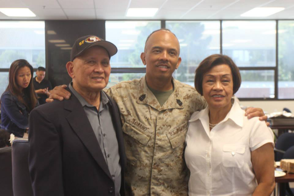 Proud parents, Eduardo and Julie, with 1st Sgt. Angel Lozano at his US Marines retirement ceremony in October 2014. (Photo courtesy of Mrs. Julie Lozano)
