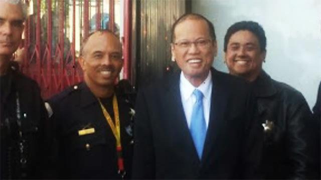 Officer Lozano with Philippine President Noynoy Aquino during the famous stopover at Haight/Ashbury . (Photo courtesy of Angel Lozano)
