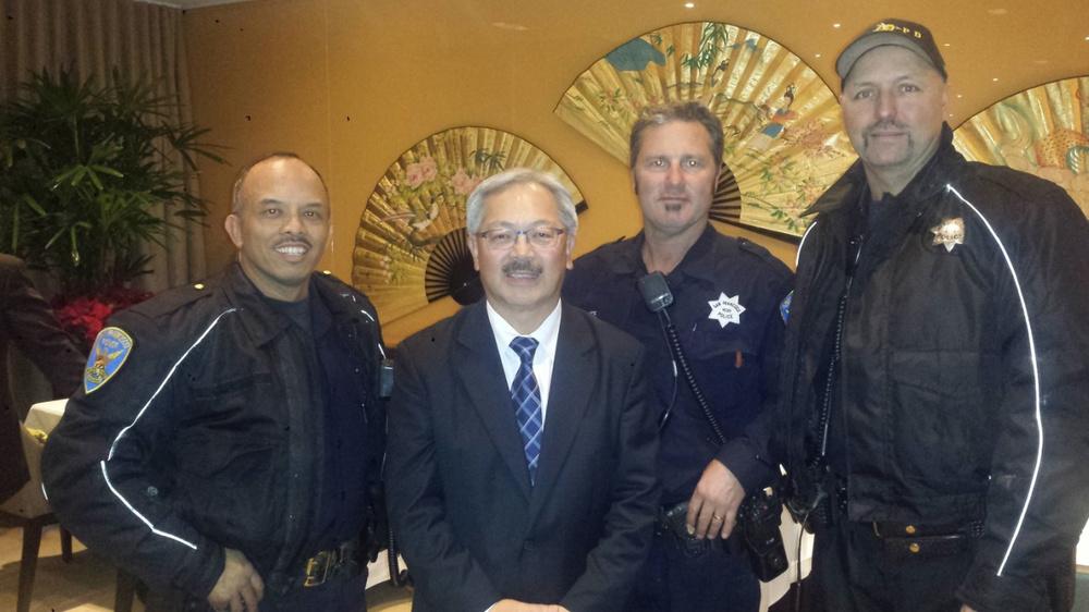 Officer Lozano and police buddies flank San Francisco Mayor Ed Lee. (Photo courtesy of Angel Lozano)