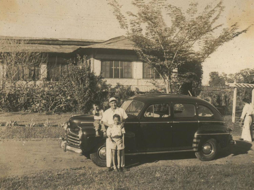 The Einsiedel father and sons c. 1952 on Agoncillo St., Area 1. The house in the background was one of the WWII-vintage sawali houses occupied by UP faculty. It was later demolished to give way to concrete houses. (Photo courtesy of Nathaniel von Einsiedel)
