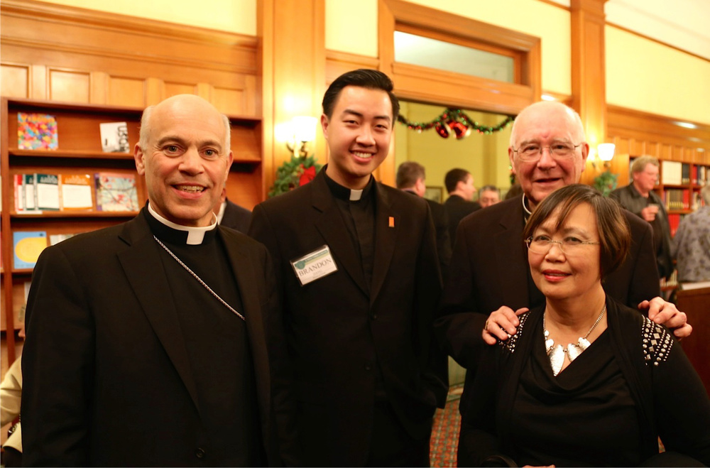 Current SF Archbishop Salvatore Cordileone, Seminarian Brandon Dang, Former Archbishop George Niederauer, and Nellie Hizon at the St. Patrick Seminary Christmas gather in 2014. (Photo by Seminarian Ernesto Jandonero)