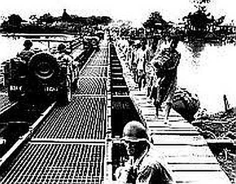 The Nagtahan Bridge across the Pasig River was built of pontoons by U.S. Army engineers. While American troops crossed it to liberate the south sector, we and streams of civilians crossed it to freedom in north Manila.