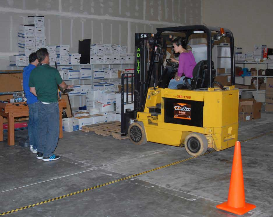 Dr. Elaine Serina, a certified forklift operator does hands-on work at her company's warehouse laboratory. (Photo courtesy of Dr. Elaine Serina)