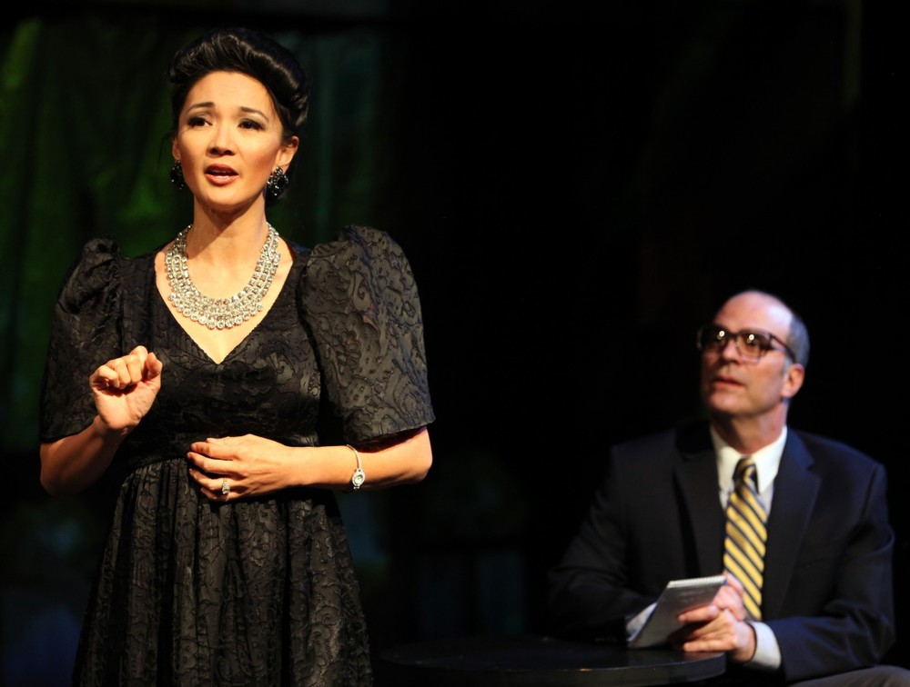 Imelda (Beverly Sotelo) is interviewed by Bob Stone (Lawrence Radecker) (Photo by Jennifer Reiley).