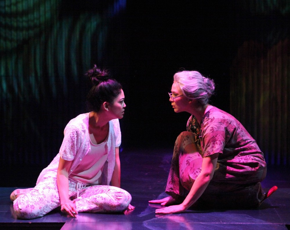 Rio (Rinabeth Apostol) shares a quiet moment with her grandmother (Charisse Loriaux)(Photo by Jennifer Reiley).