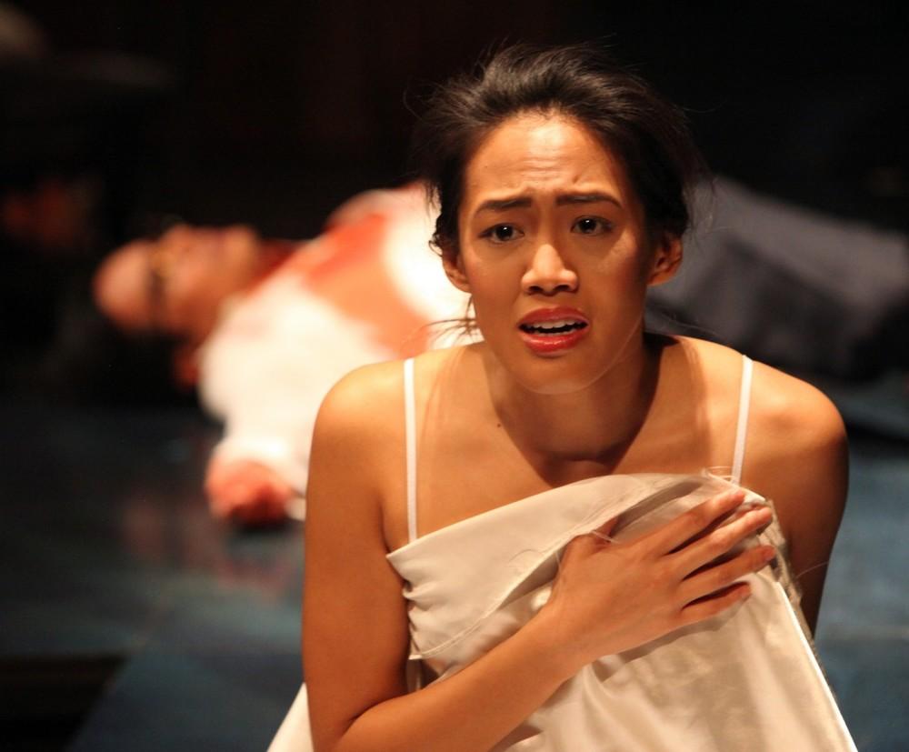 Daisy (Christine Jamlig) wakes to her father's (Ogie Zulueta) assasination (Photo by Jennifer Reiley).