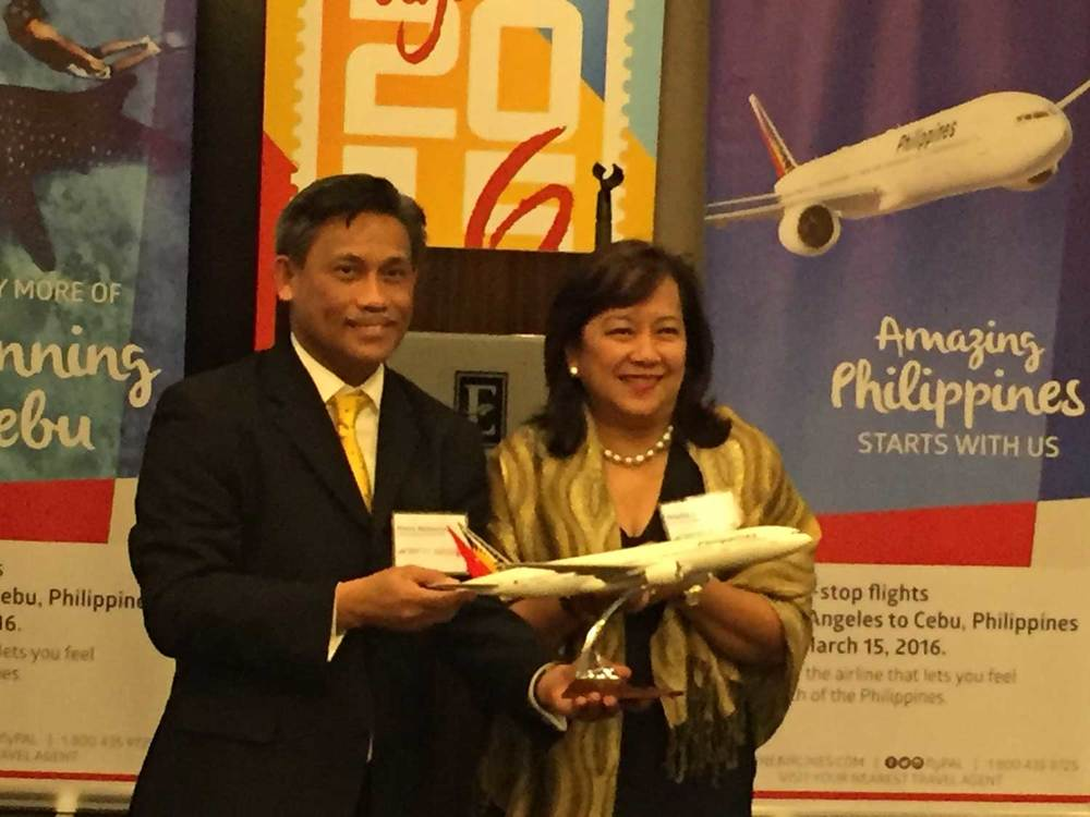 Consul General Henry Bensurto, Jr. with Philippine Airlines Country Manager Marila Revilla