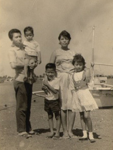 Family photo near Samonte Park in Cavite City. Mom (Lily) & Dad (Roger) with sister Lulu (Luisa), Ronnie and the youngest, Ricky (Photo courtesy of Ronnie del Carmen)