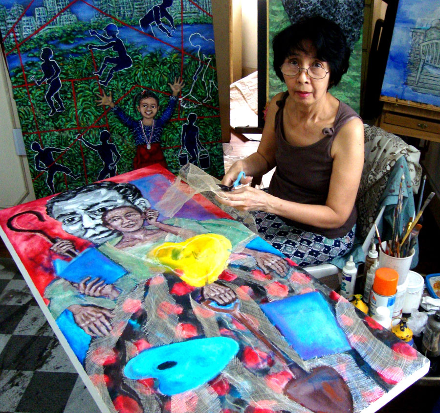 The artist at work on Pusong Wagas (Pure Heart; 2013), taken from Andres Bonifacio's poem Pag-ibig sa Tinubuang Lupa. (Photo is courtesy of Imelda Cajipe Endaya)
