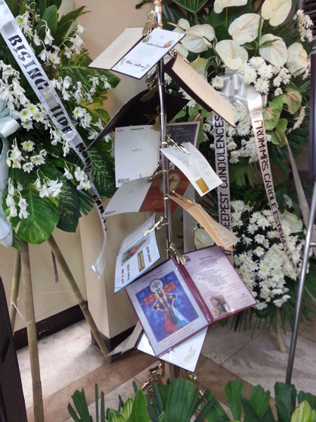 Floral arrangements and mass cards at Philippine funerals (Source: philippineobservers.wordpress.com)