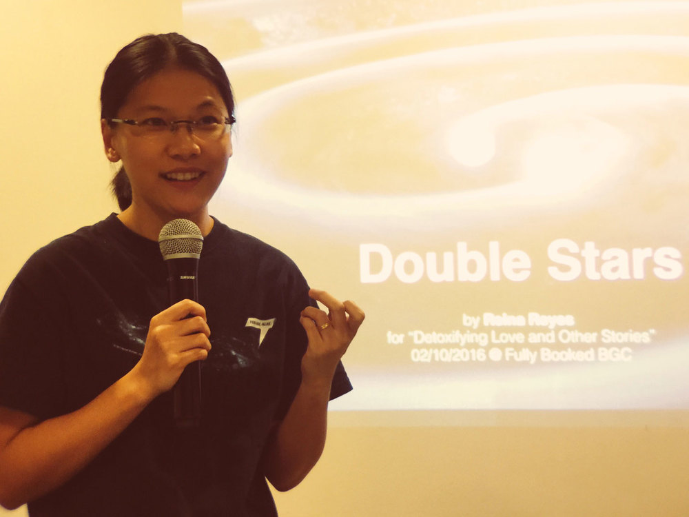 "Reina at a Valentine's lecture entitled ""Double Stars"" where she talked about the lives of (binary) stars as a metaphor for relationships: ""Are you in a stable long-term gravitational embrace or in a mutually self-destructing system ready to go SUPERNOVA?"" (Photo by Gary Coronado)"