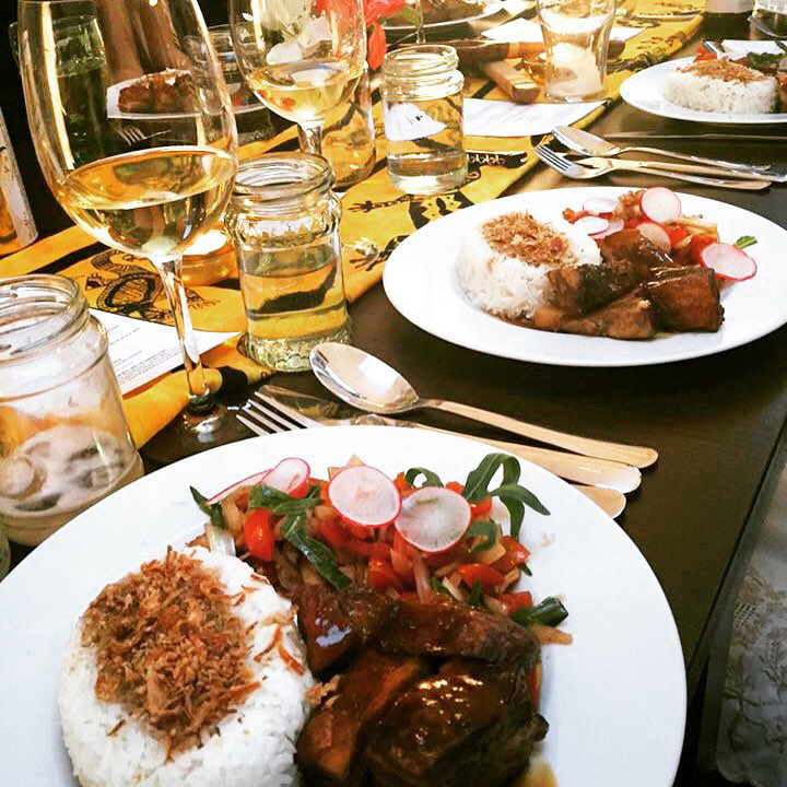 Pork belly adobo served with a tomato-onion salad and rice. (Photo by Mary-Ann Fleras)