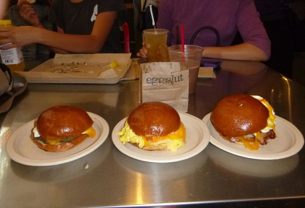Three unadorned Eggslut sandwiches: (left to right) Sausage, Egg & Cheese ($7); Fairfax ($7); and Bacon, Egg & Cheese ($6).