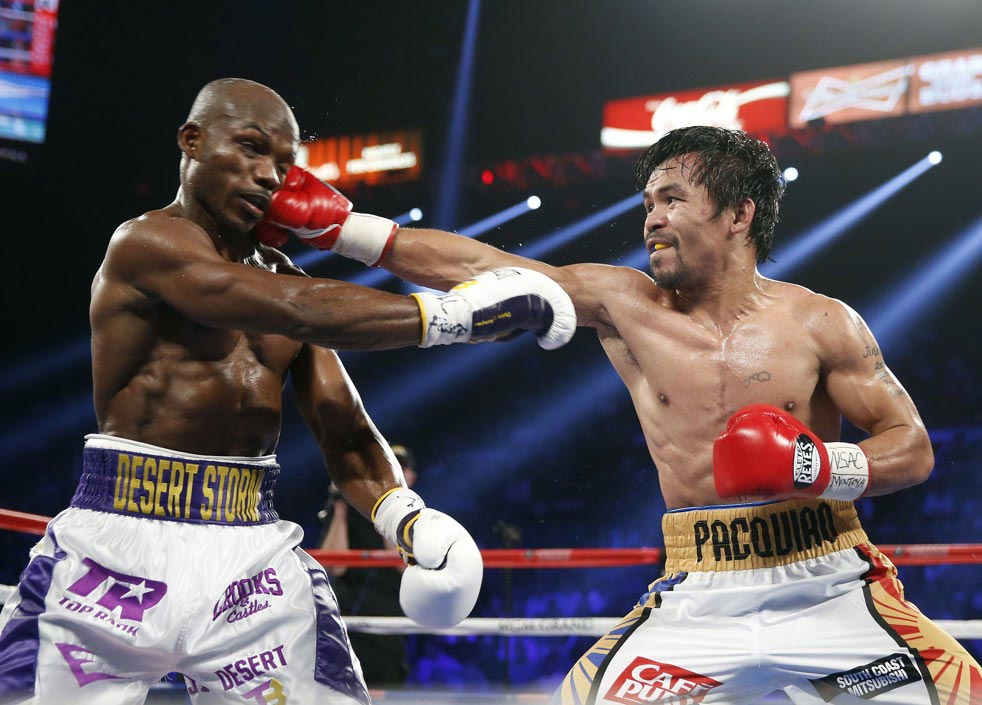 Manny Pacquiao (left) beats Timothy Bradley by unanimous decision in their WBO welterweight championship fight at MGM Grand Arena in Las Vegas (Photo by Isaac Brekken/AP)