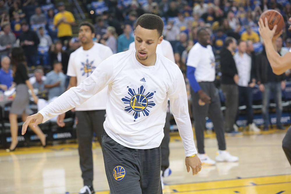 Golden State Warriors' Stephen Curry in the white Filipino Heritage Night shirt (Source: Golden State Warriors)