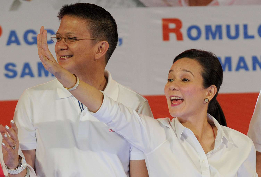 Senator Grace Poe with running mate Senator Chiz Escudero (Photo by AFP/The Straits Times)