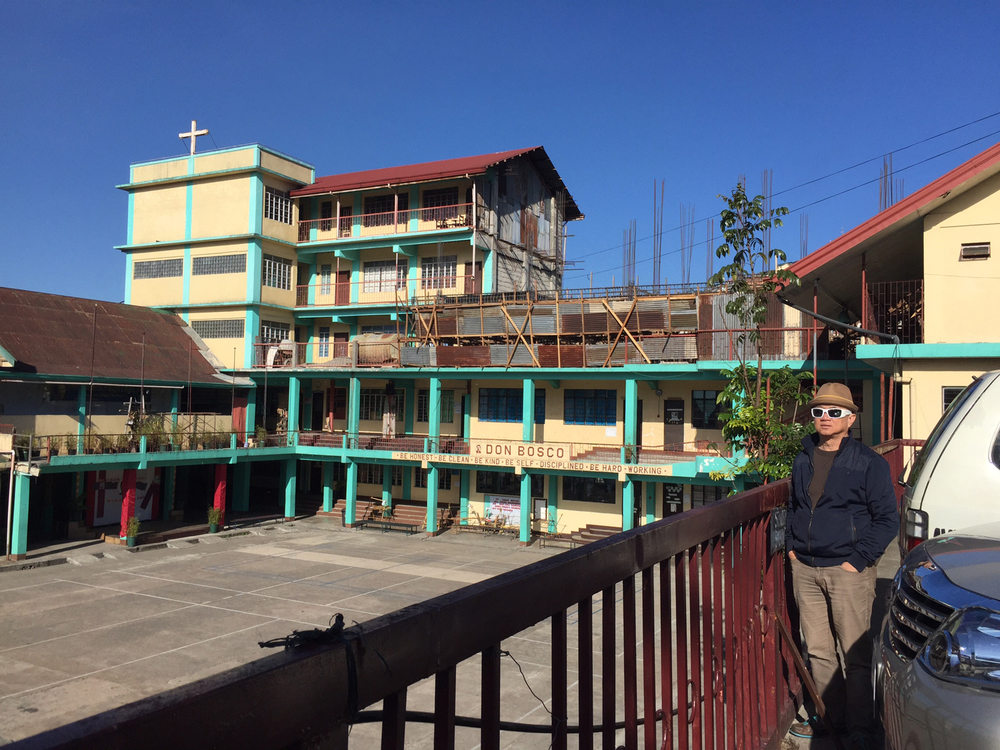 The author and his alma mater, Don Bosco High School (Photo courtesy of Rene Astudillo)
