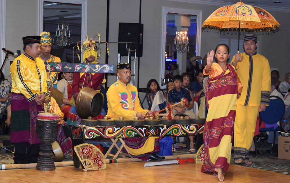 Bernard (seated at the Kulintang) with the Samahan Pakaraguian Kulintang Ensemble performing a Maranao dance (Photo by R. Profet)
