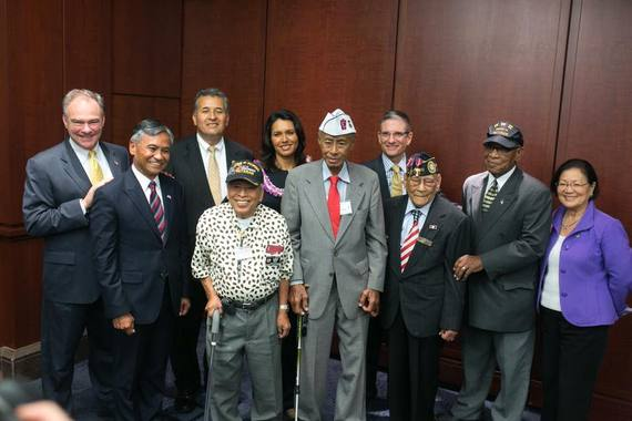 Jesse Baltazar, sixth from the left, at the introduction of the 2015 Filipino Veterans Congressional Gold Medal Act (Source: Huffington Post)