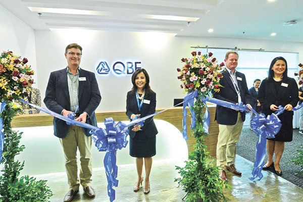 From left to right: Mike Emmett, Group Executive Officer of Operations at QBE Insurance Group; Karen; Steven Burns, Chairman of QBE Group Shared Services Limited; and Joli Wu, President & CEO of QBE Seaboard Insurance Philippines at the ribbon cutting ceremony during the launching of the QBE office in Skyrise Alpha building at the Cebu Business Park in May 2015. (Source: SunStar/ Photo by Amper Campaña)