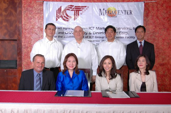 Karen as the president of the ICT Group Philippines in 2008 (first row, second from right), in a contract signing event CHAS Realty and Development Corporation. (Source: Megacenter: The Mall)