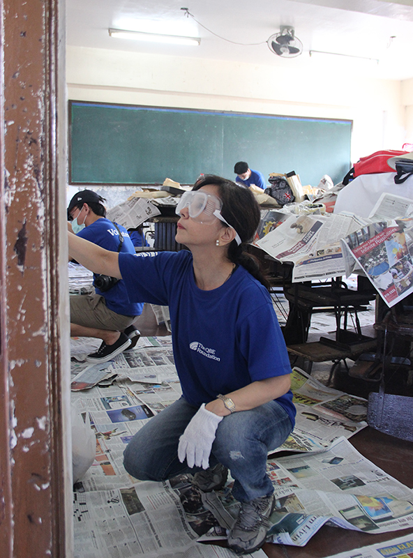Karen and her team repainting classrooms in 2014 as part of Servathon, QBE's annual community service program. (Source: QBE)