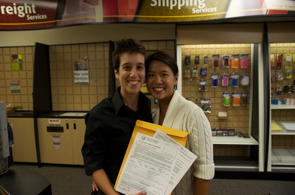 Lisa and Jenni formalized their Domestic Partnership in 2012 at Westlake Mall UPS Store. (Photo printed with permission by Lisa Dazols)
