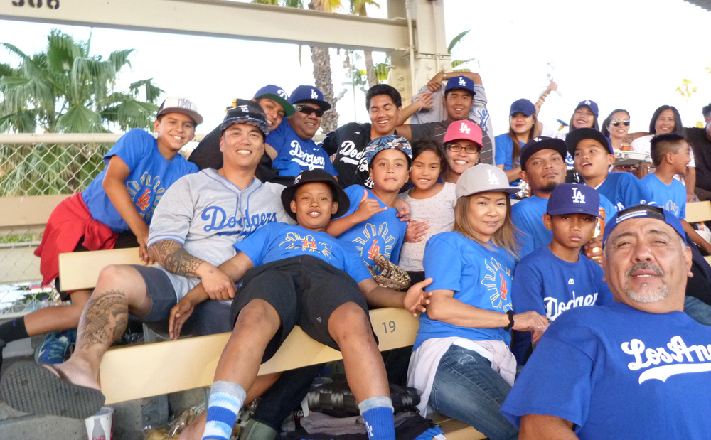 Filipino fans jump in for a photo opportunity during this year's LA Dodgers' Filipino Night (Photo by Anthony Maddela)