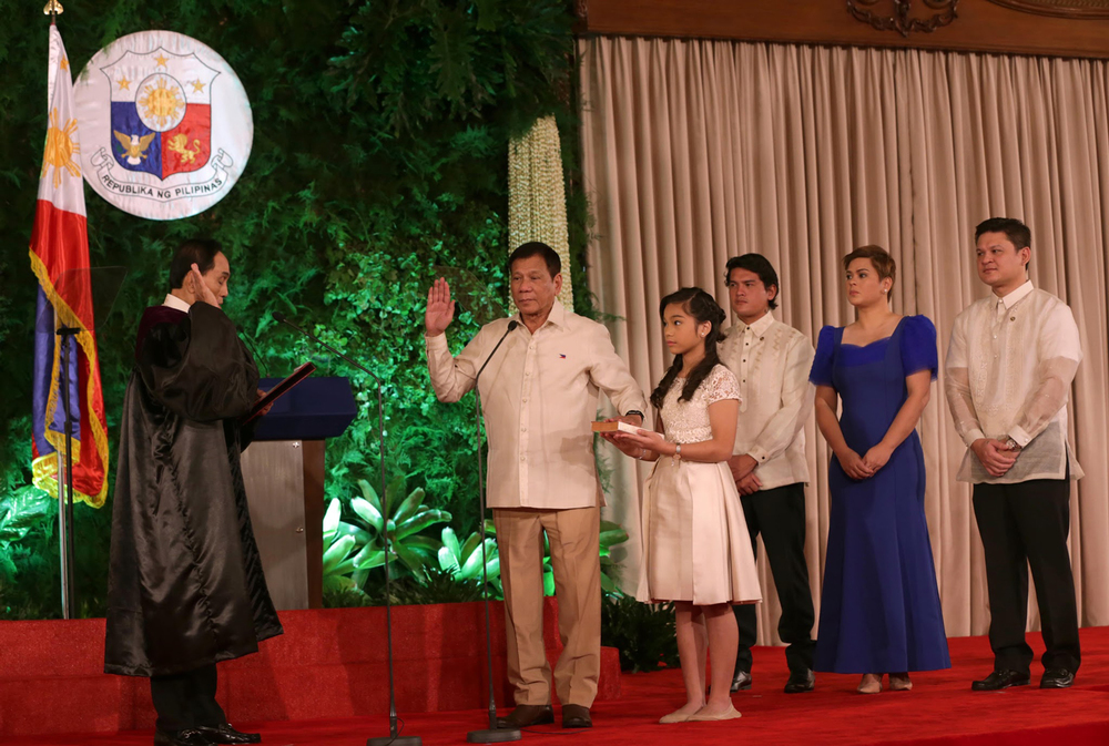 President Rodrigo Duterte taking his oath of office. (Photo by the Presidential Communications Operations Office)