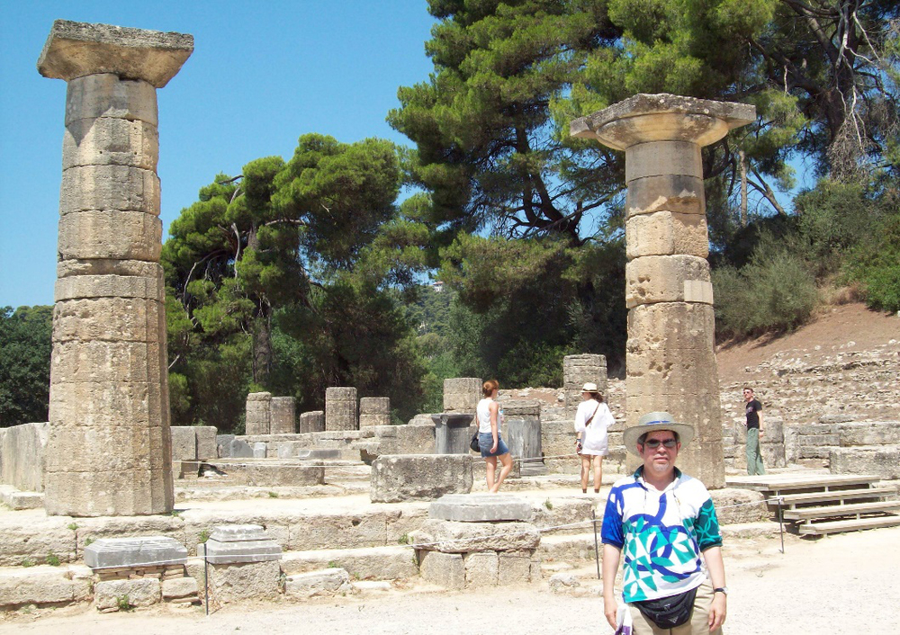 Author in front of the 2,800-year-old Temple of Hera in Olympia, Greece, July 2010. Temperatures in the Olympic grove can reach as high as 95⁰ C in July and August.  (Photo courtesy of Myles A. Garcia)