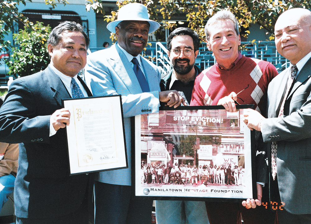 San Francisco community leaders gather to commemorate the anniversary of the I-Hotel eviction in 2002 and to celebrate the eventual construction of affordable housing on the hotel's old site. (L-R) Manilatown Heritage Foundation President Emil de Guzman, San Francisco Mayor Willie Brown, City Supervisors Aaron Peskin and Tom Ammiano. (Photo by Cherie Querol Moreno)