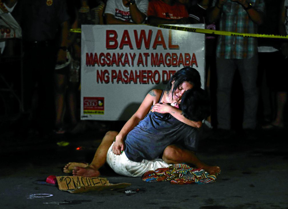 """La Pieta"" (Photo by Raffy Lerma/Philippine Daily Inquirer). Public outrage over recent killings of suspected drug pushers has reached international attention."