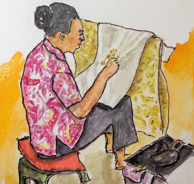 Balinese Artisan applying wax designs to cloth in preparation for the dyeing process (from the watercolor travel sketchbook of Jojo Sabalvaro Tan, February 2016)