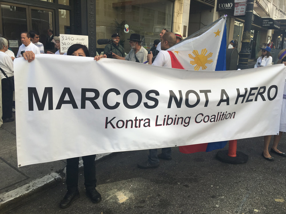 In San Francisco, a multigenerational rally of anti-Marcos activists oppose President Rodrigo Duterte's decision to bury Ferdinand Marcos at  Libingan ng mga Bayani  (the Heroes' Cemetery) (Photo by Gary De Guzman).