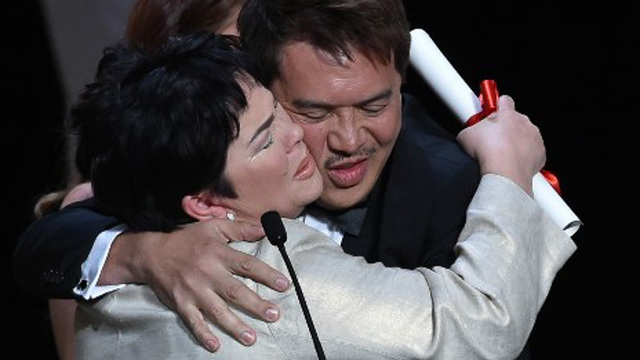 "Brillante Mendoza and Jaclyn Jose embrace after her winning the best actress award for her role in ""Ma' Rosa"" at this year's Cannes Film Festival (Photo by Alberto Pizzoli/AFP)"