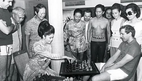 This photo, taken sometime in 1973, shows First Lady Imelda playing the black piece against renowned American chess prodigy Bobby Fischer while President Marcos looks on in their match.