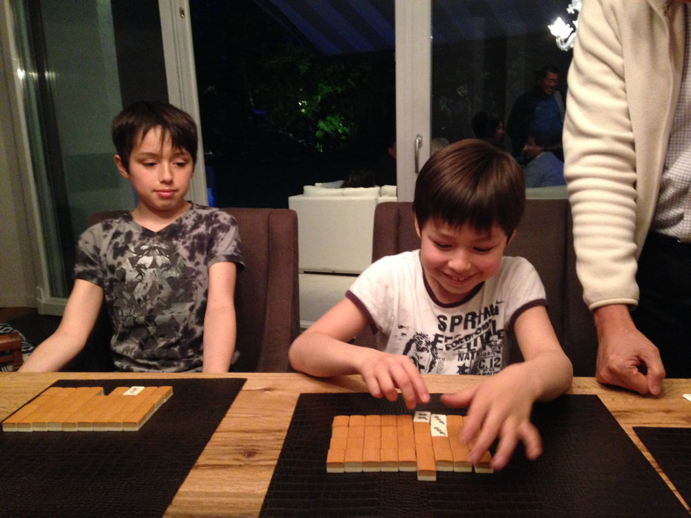 Hector Moreno's great grandsons William and Sean Rankl get introduction to mahjong.