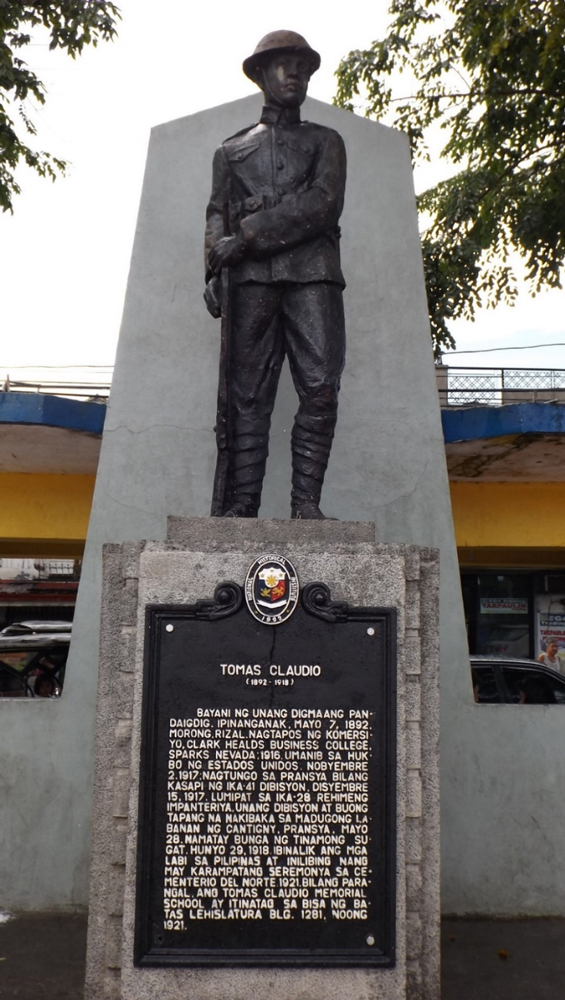 The memorial at Private Tomas Claudio's grave at the Manila North Cemetery today.