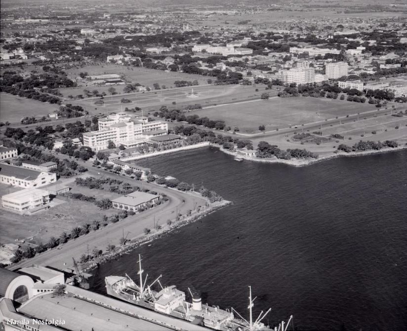 Pier 7 at the bottom of the photo. The Manila Hotel is the white structure in the middle. (courtesy NASM Archives)