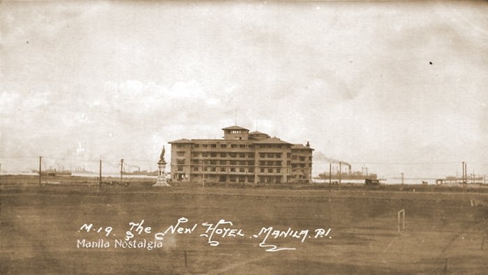 Newly built, the Manila Hotel in 1913 framed against Manila harbor.