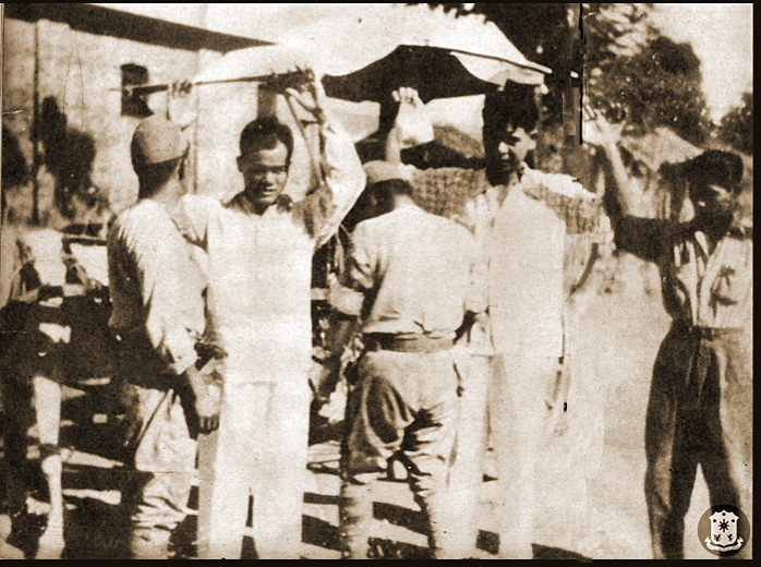 Japanese frisking Filipinos (Photo courtesy of Presidential Museum and Library)