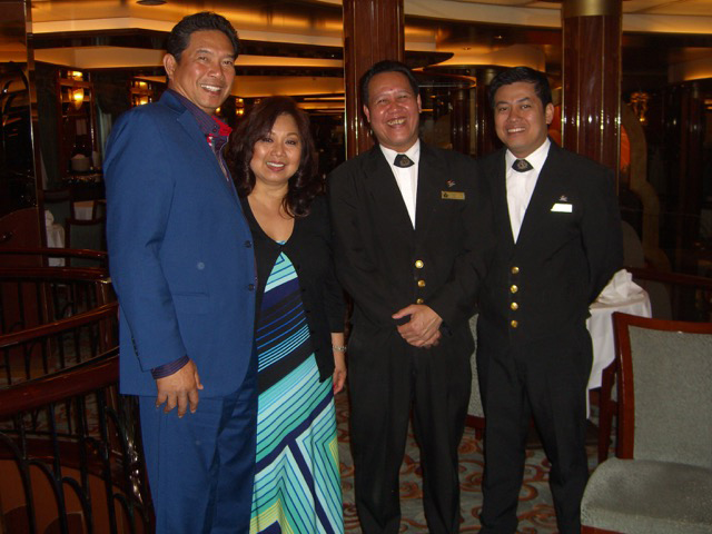 Joe & Lynn Santos with Filipino waiters Henry Pagdanganan & Roger Bejosano, who pampered us every single night during our seven-day voyage. Words can not express our gratitude and appreciation to these two hardworking Pinoys who have been working with Cunard's Queen Victoria for more than 10 years (Photo courtesy of Joe and Lynn Santos)