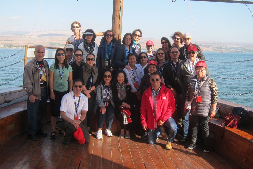 Members of the pilgrimage pose for a souvenir shot on the boat ride on the Sea of Galilee.