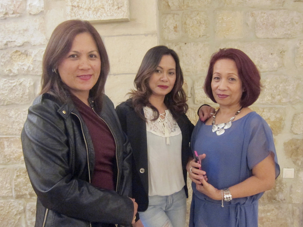 All dressed up for a night out after Saturday evening Mass (left to right), Angie Tamesis who has been in Israel for eight years, Chona Lubi for 10 years and Lyn Gutierrez for 14 years. The three are caregivers. (Photo by Mona Lisa Yuchengco)