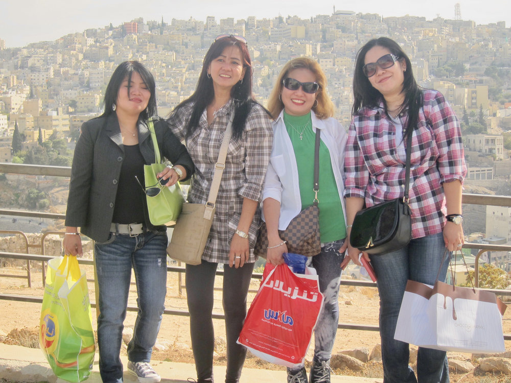 Caregivers on their Friday day-off at the Citadel in Amman, Jordan (left to right): Rowena Costin hails from Tacloban and has been in Amman for seven years; Frenie Espino, from Pangasinan has been a housekeeper for 11 years; Zenaida Onio is from Nueva Ecija and has been in Jordan for 15 years; Lourdes Buensalida, 13 years in Jordan, is from Bicol. They say their employers are all very nice and kind. They also say that there are many Filipino construction workers and miners in Jordan. They offered to share their food with me: hipon sa gata at piniritong isda (shrimp in coconut milk and fried fish). This was so tempting after eating hummus every day! (Photo by Mona Lisa Yuchengco)