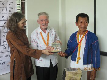 Antoon Postma (center) donating an ambahan collection to the U.S. Library of Congress (Photo courtesy of Mangyan Heritage Center).