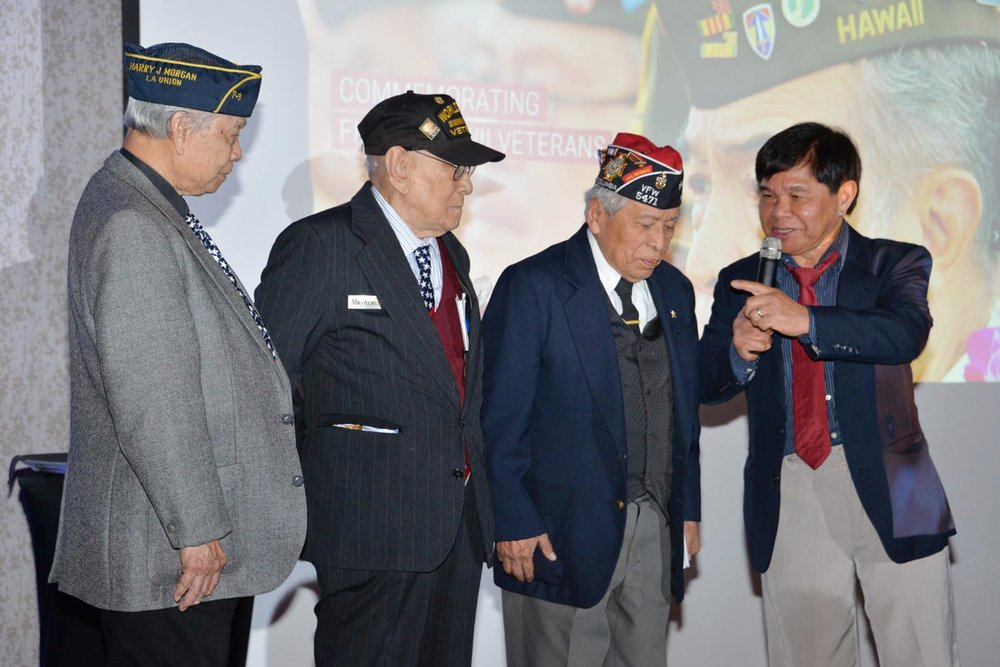 The author (right) introduces Filipino WWII Veterans (from left) Rudy Panaglima, Celestino Almeda and Rey Cabacar at a community event honoring their service and sacrifice. (Photo by Ramon Talusan)